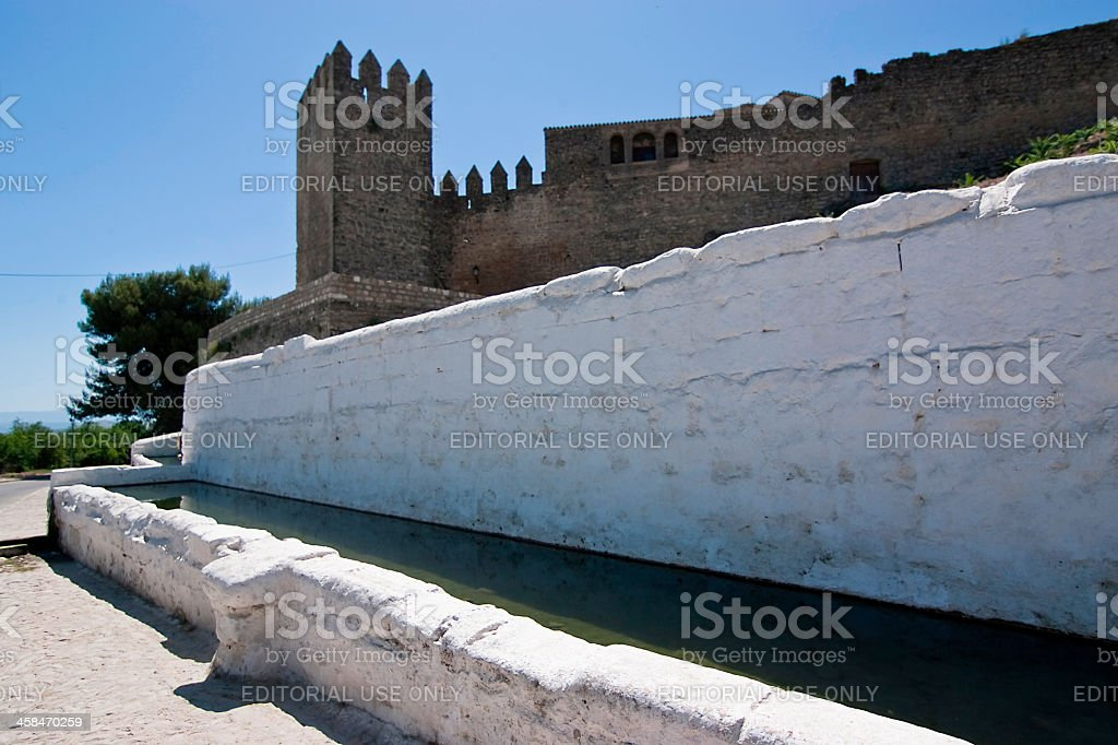 Drinking trough and Tower of the Barbacana, Sabiote, Jaen, Spain stock photo