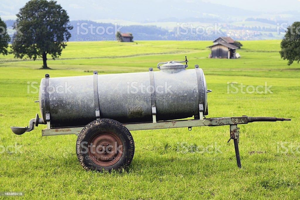 Drinking trough vehicle on pasture range royalty-free stock photo