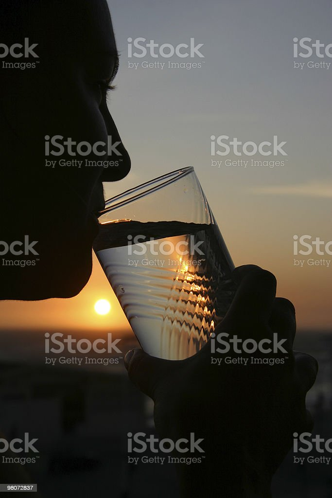 Drinking Water Against Sunset royalty-free stock photo
