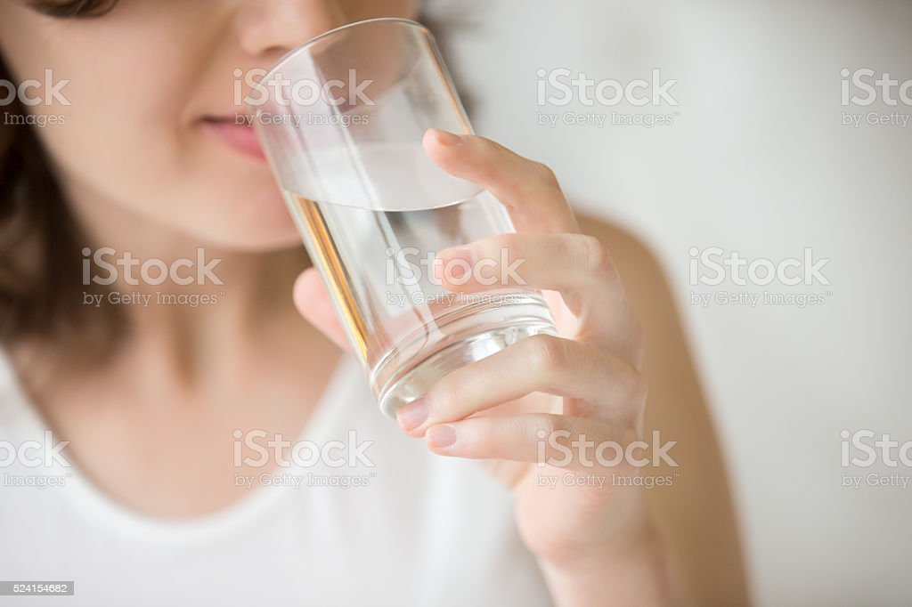 Drinking water closeup stock photo