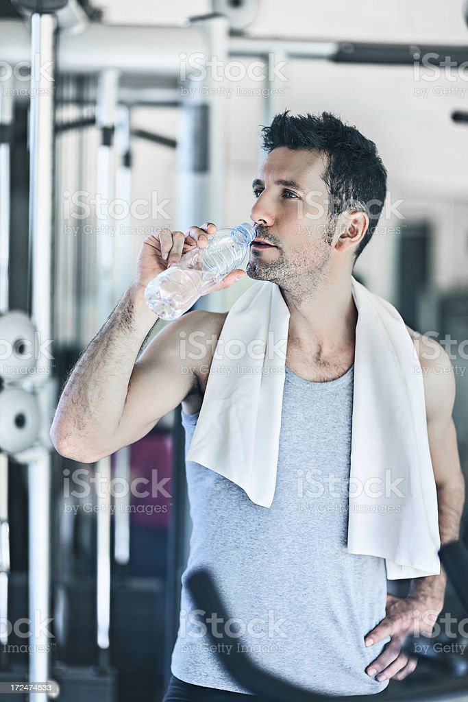 Drinking water in the gym royalty-free stock photo
