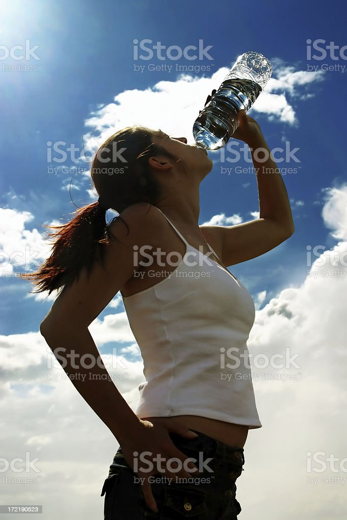 Drinking water (against the sun) royalty-free stock photo