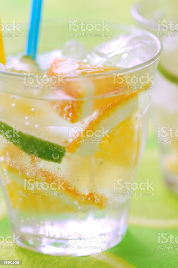 Drinking water with lime and orange stock photo