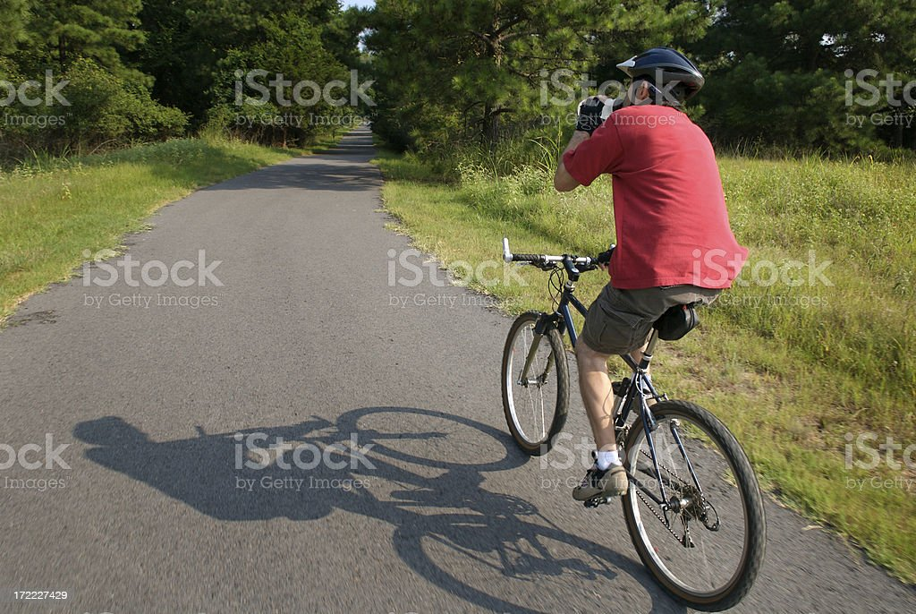 Drinking while Bicycling in the Park royalty-free stock photo