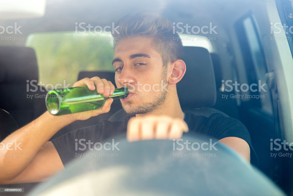 Drinking while Driving a Car stock photo