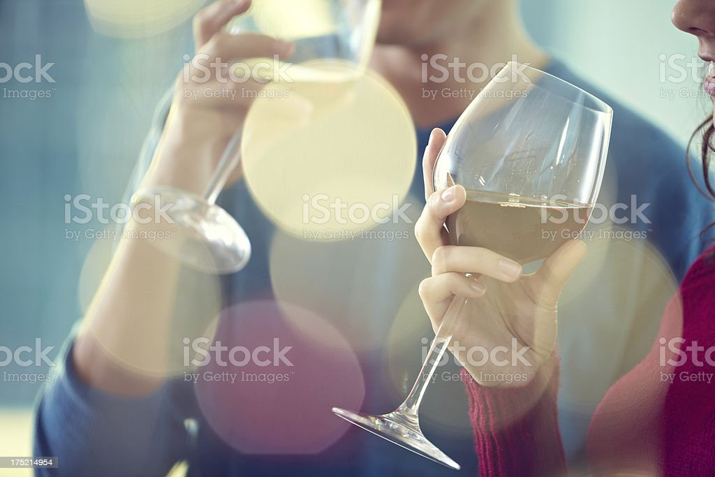Drinking white wine royalty-free stock photo