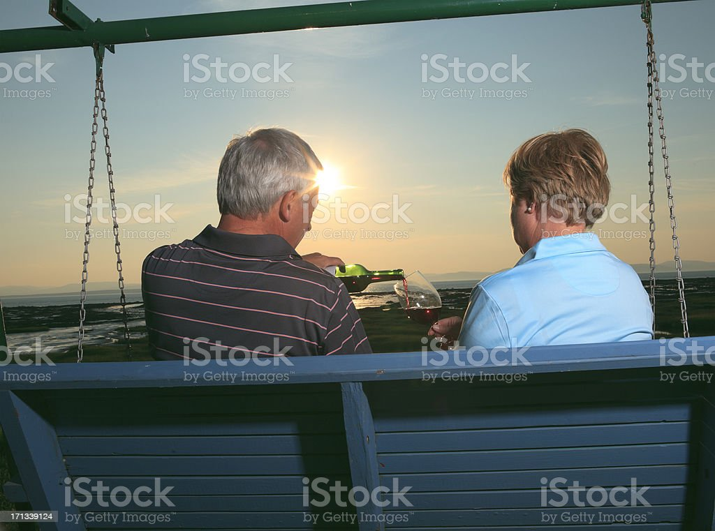 Drinking Wine at Sunset royalty-free stock photo