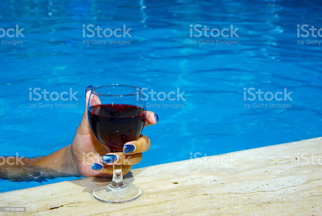 Drinking wine in the pool stock photo