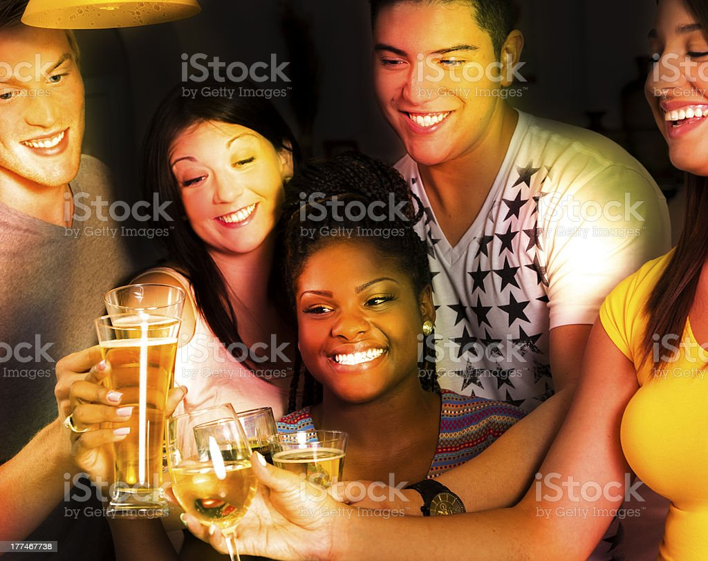 Drinks:  Friends enjoying good times together. royalty-free stock photo