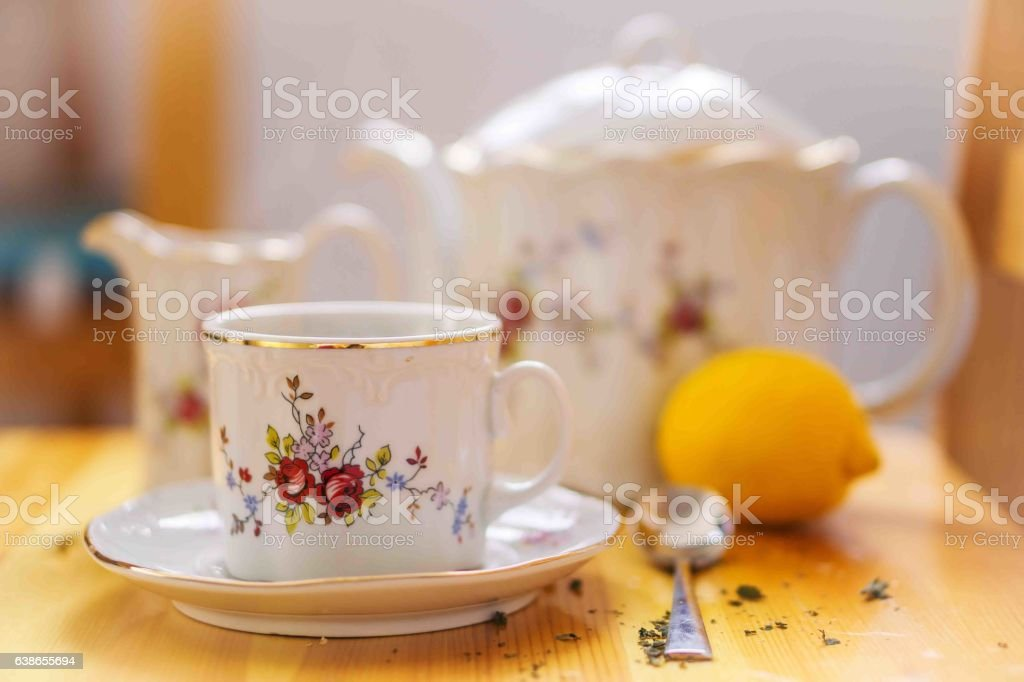drinks, relaxation and tea-set of cup, pot, spoon, lemon and saucer stock photo