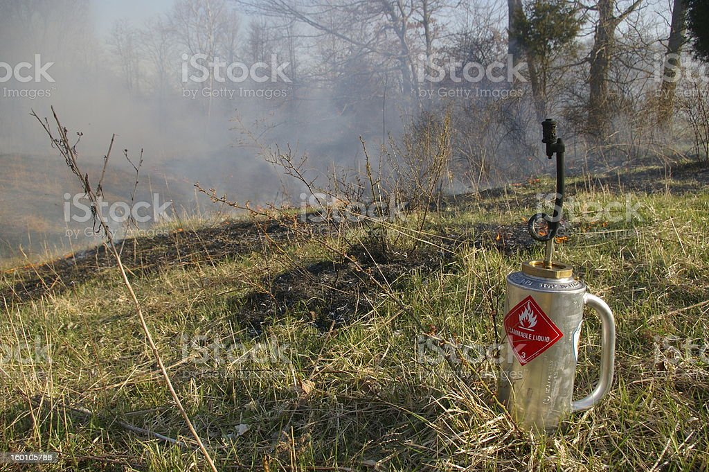Drip Torch and Field Fire stock photo