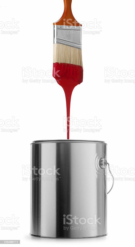dripping red paint brush in can stock photo