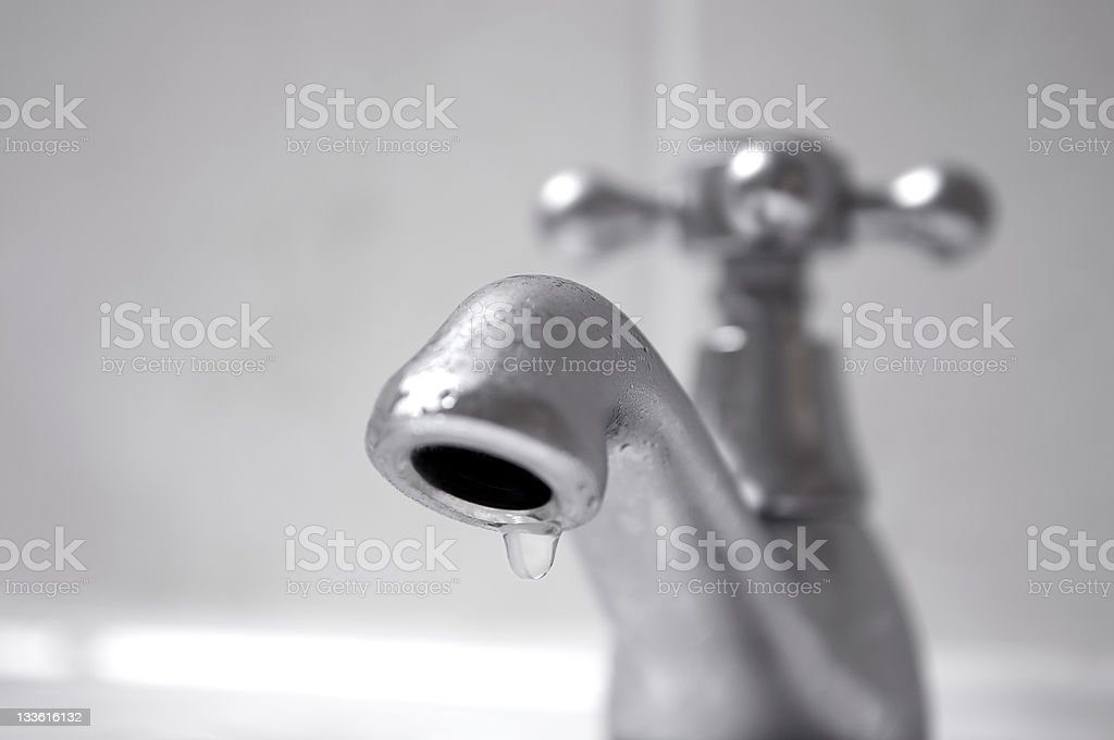 Dripping silver tap water close up stock photo