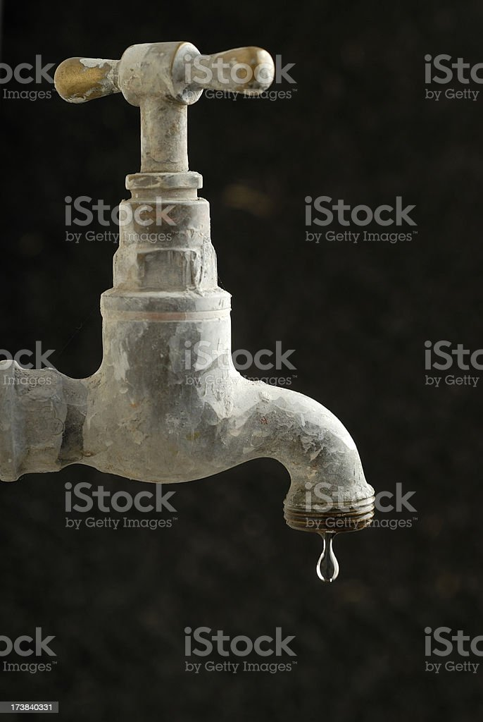 Dripping tap single drop stock photo