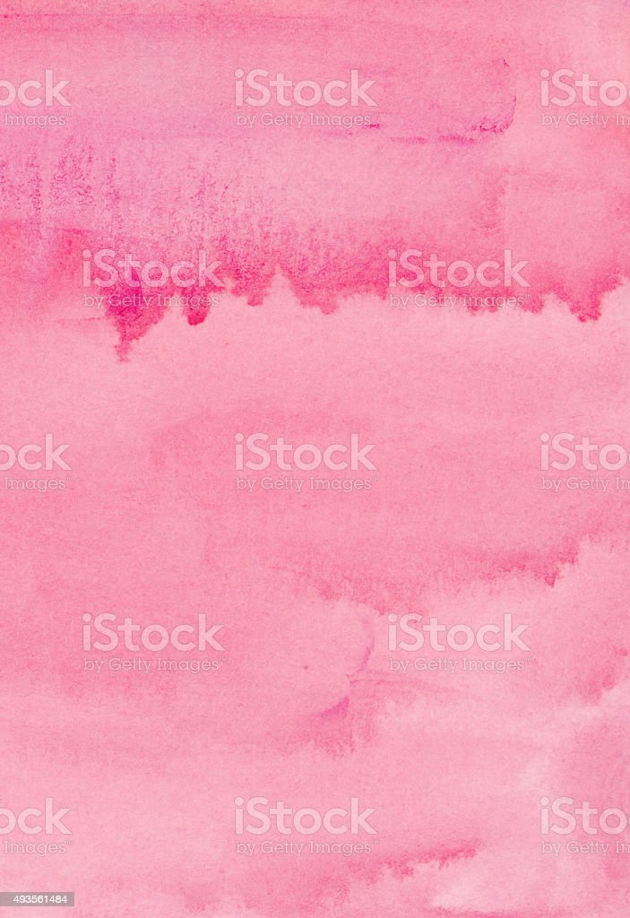 Drips of paint on a pink watercolor background stock photo