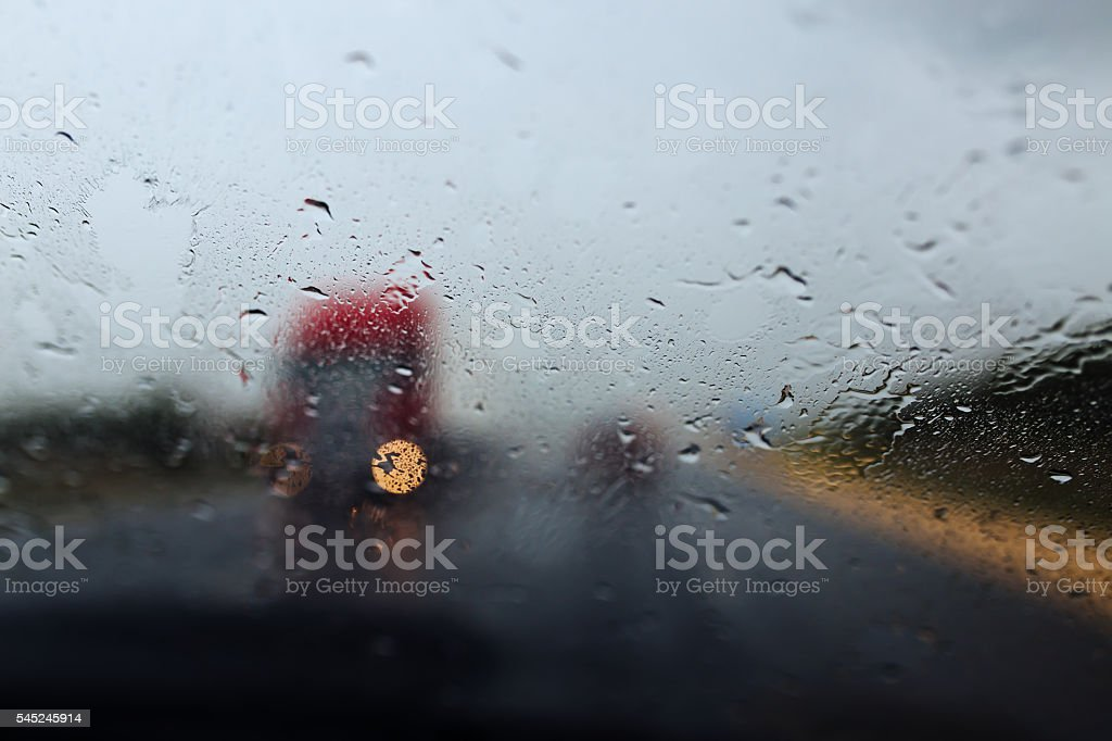 Drive car at heavy rain. Water drops at window stock photo
