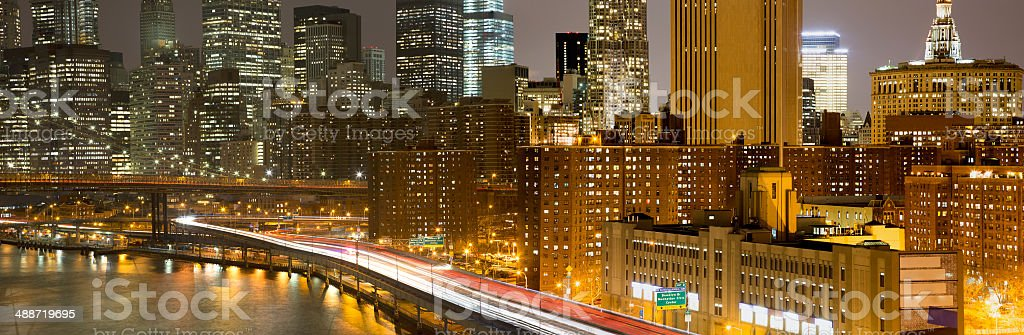 FDR Drive Leading Into Manhattan Skyscrapers at Night, New York stock photo