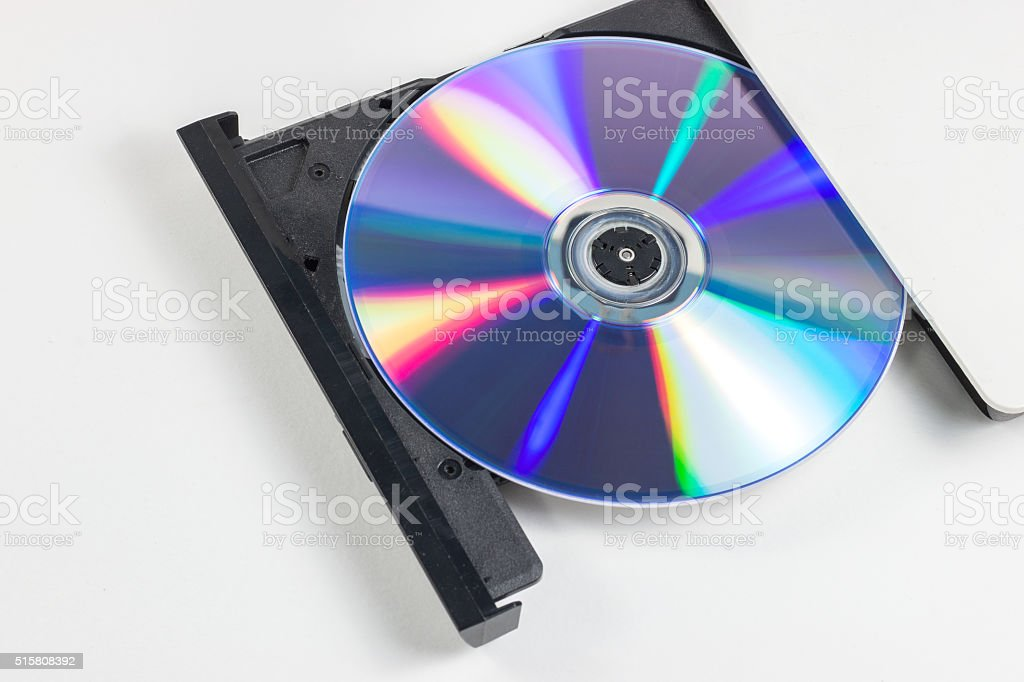 DVD drive open on white background (Selective focus) stock photo
