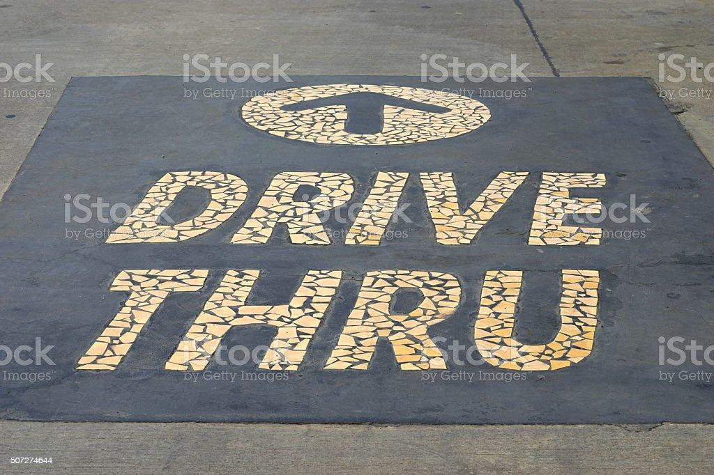 drive thru sign on the ground stock photo