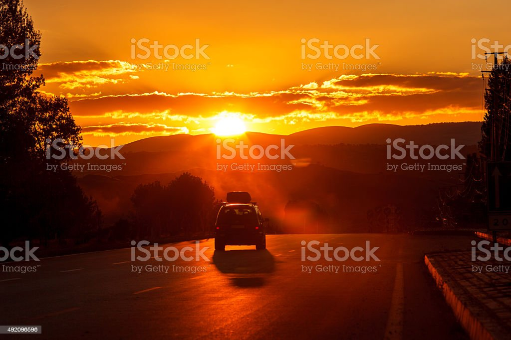 Drive to sunset stock photo