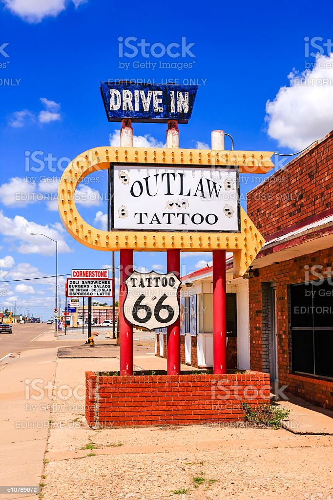 Drive-In Route 66 Outlaw Tattoo Shop sign in Tucumcari, NM stock photo