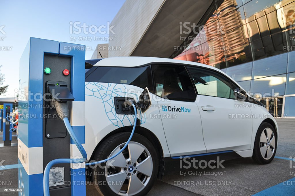 DriveNow BMW i3 at charging station in Munich, Germany stock photo