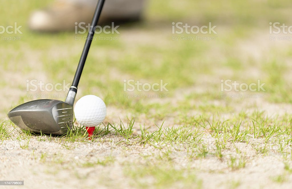 Driver and ball on tee royalty-free stock photo