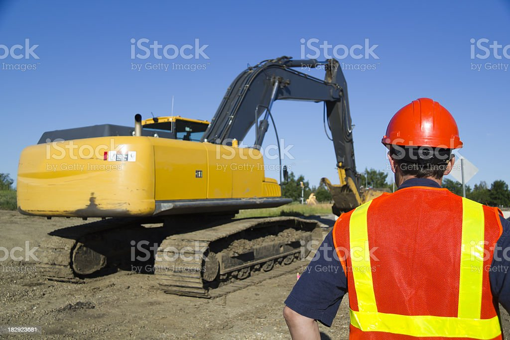 Driver and Excavator royalty-free stock photo