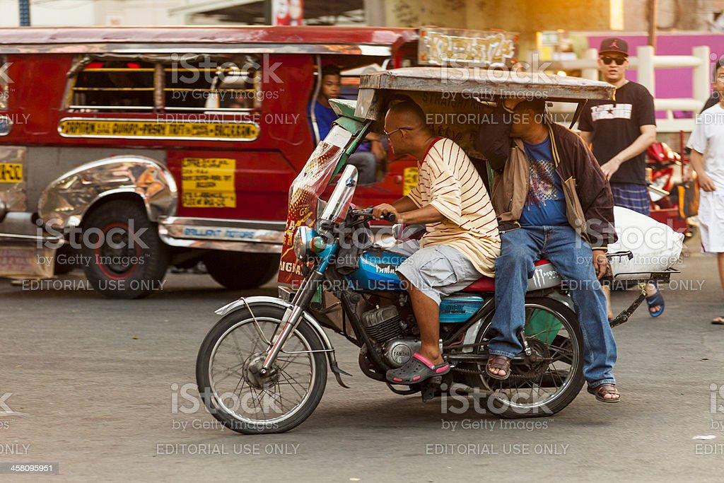 Driver and passenger on a motorcycle rickshaw, Metro Manila stock photo