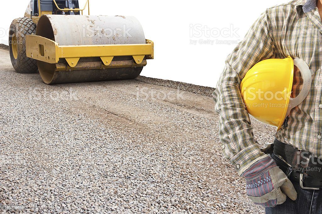 driver and soil compactor during road construction work on white royalty-free stock photo