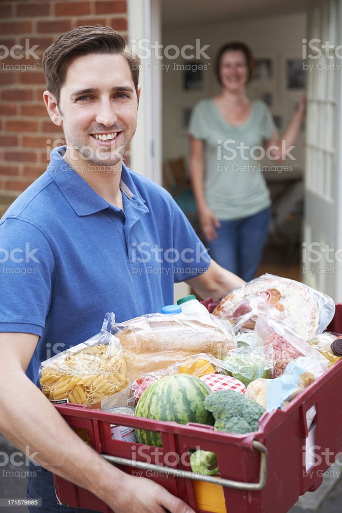 Driver Delivering Online Grocery Order royalty-free stock photo