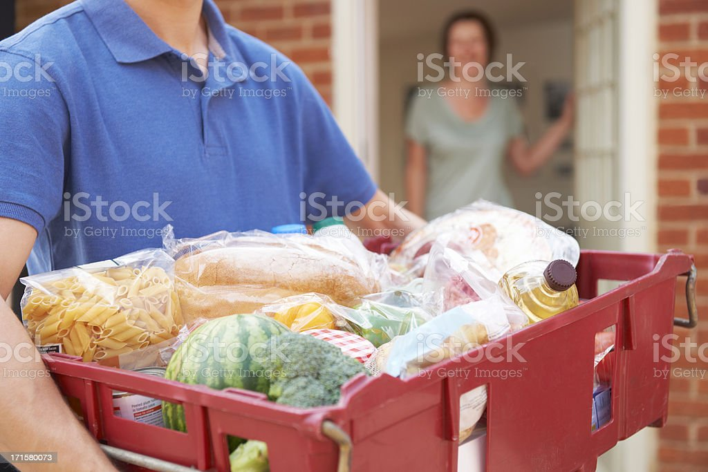 Driver Delivering Online Grocery Order stock photo