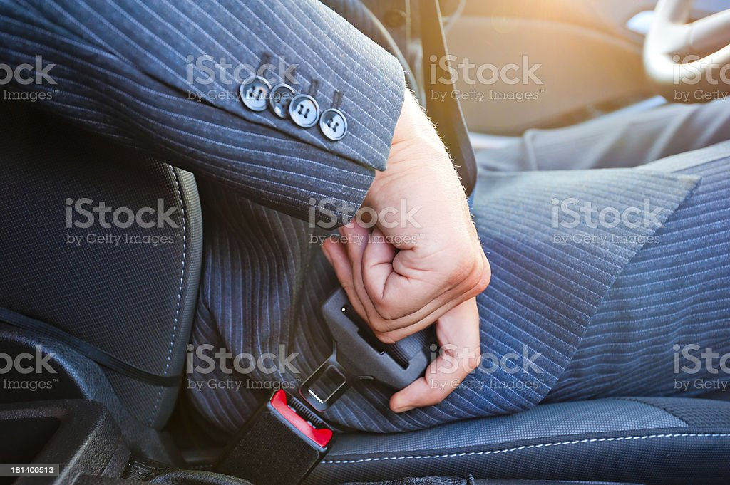 Driver  fastens his seat himself automobile belt stock photo