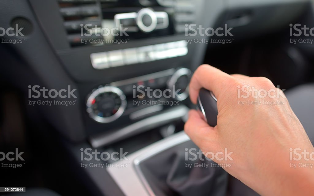 driver hand shifting the gear stick stock photo