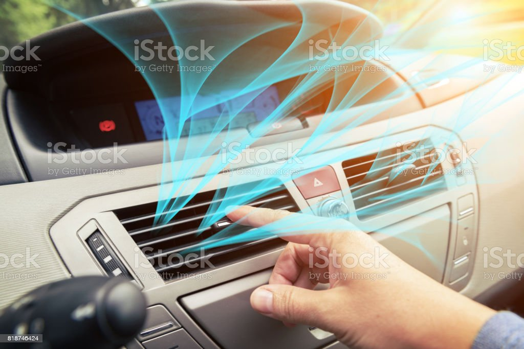 Driver hand tuning air ventilation grille stock photo