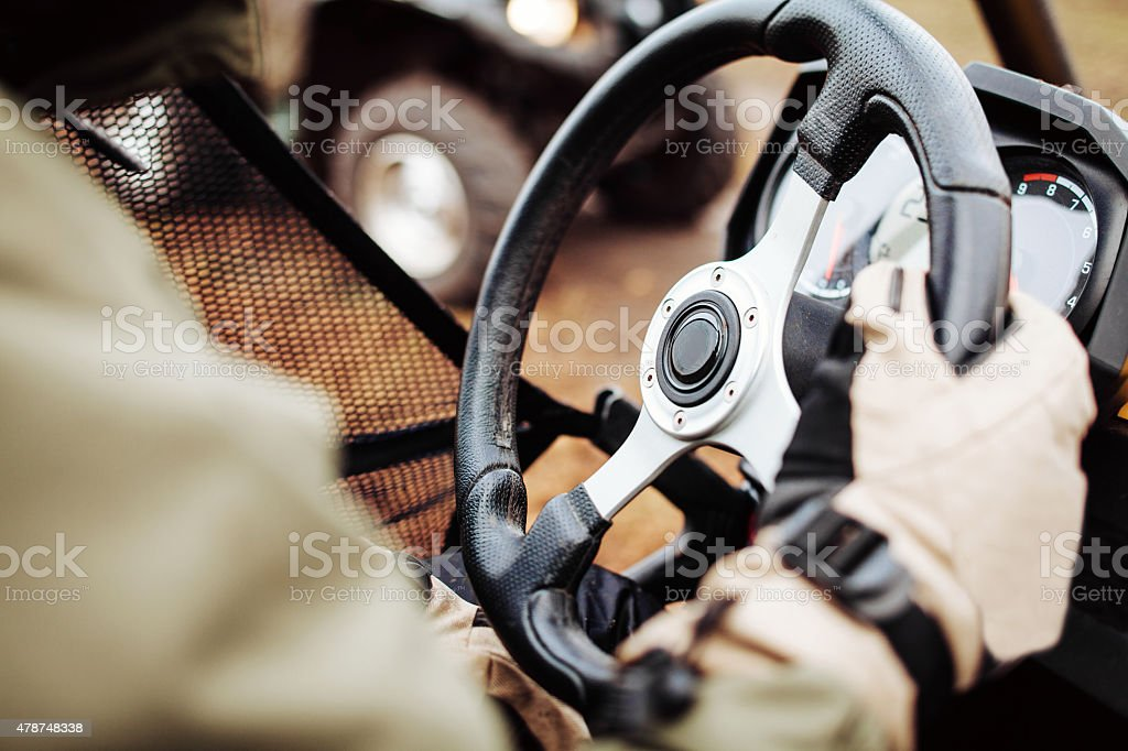 driver holds the steering wheel with gloves stock photo