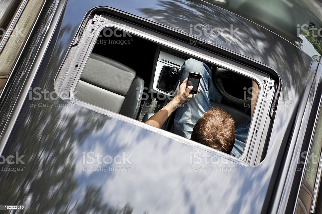 Driver Illegally Texting at Wheel of Car royalty-free stock photo