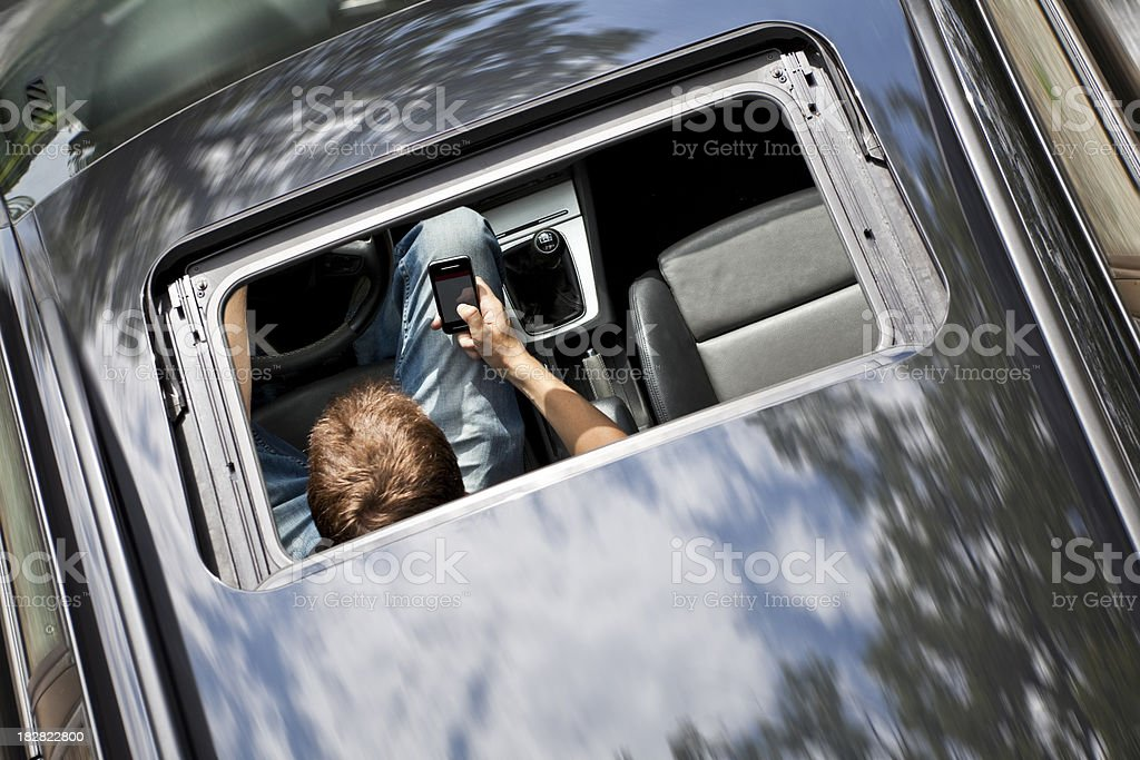 Driver Illegally  Texting at Wheel stock photo