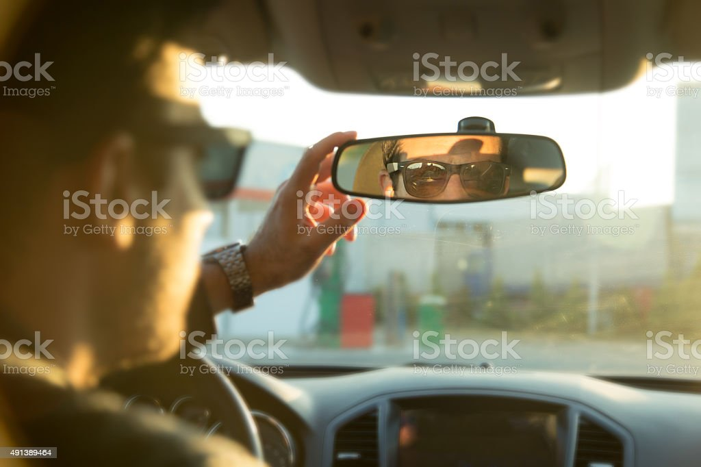 Driver In Rear-View Mirror stock photo