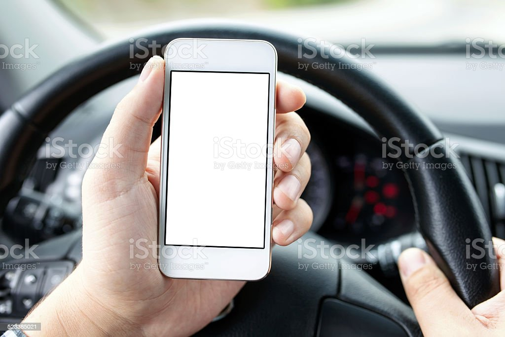 driver in the car holding phone with isolated screen stock photo