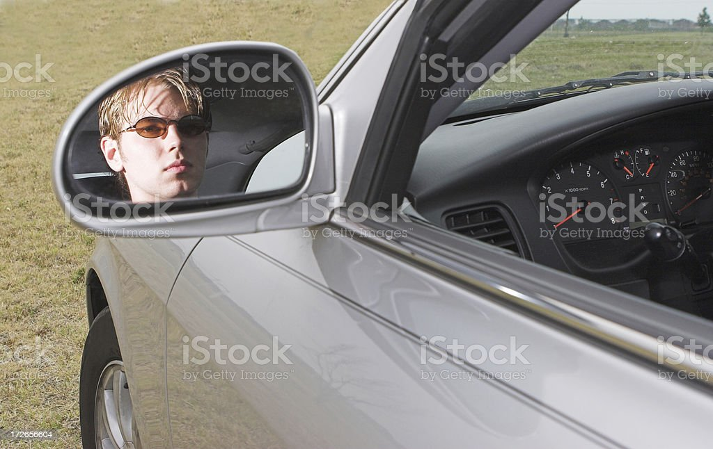 Driver in the mirror royalty-free stock photo