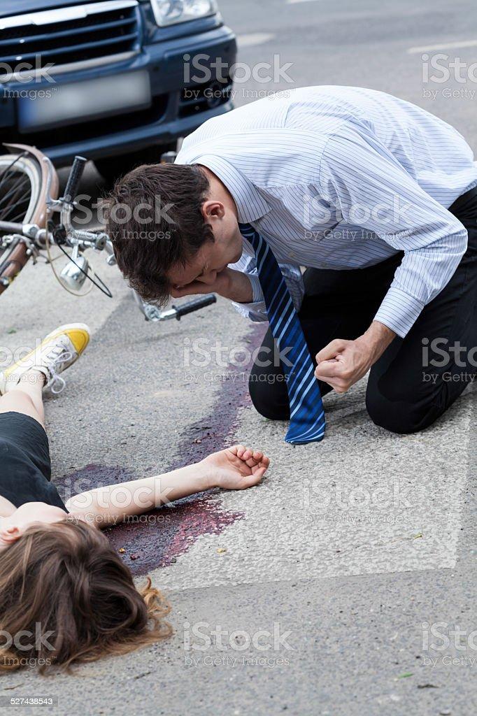 Driver killing a cyclist stock photo