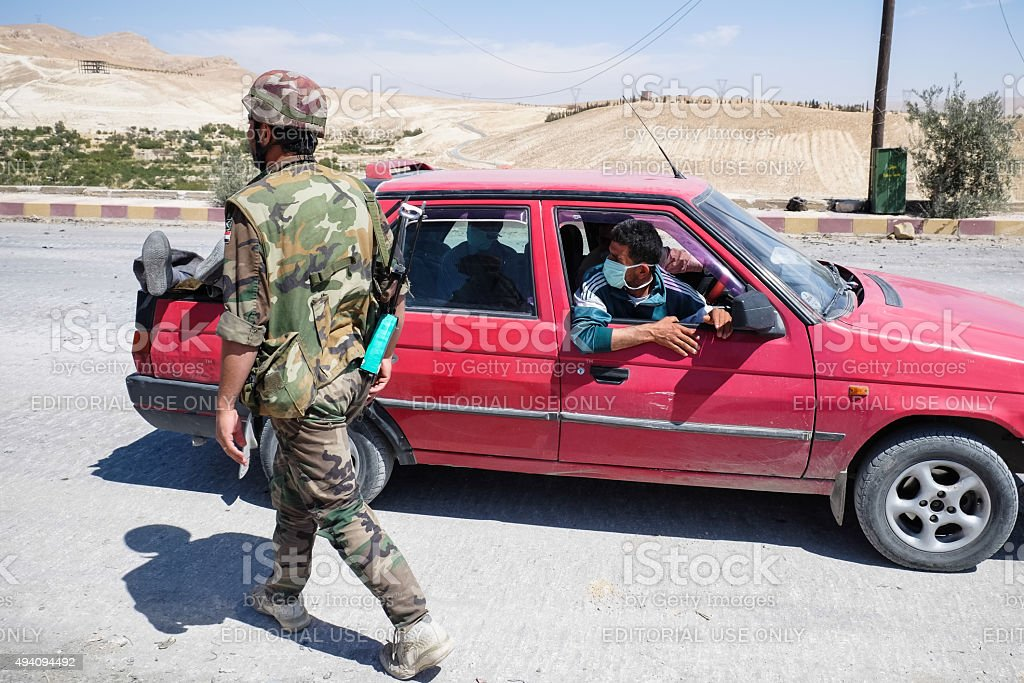 Driver lucky to bury people killed by militants in Maaloula stock photo