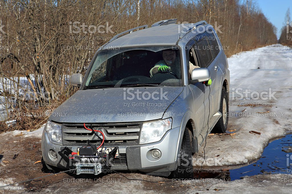 Driver of jeep winch controls remotely your vehicle gets stuck. stock photo