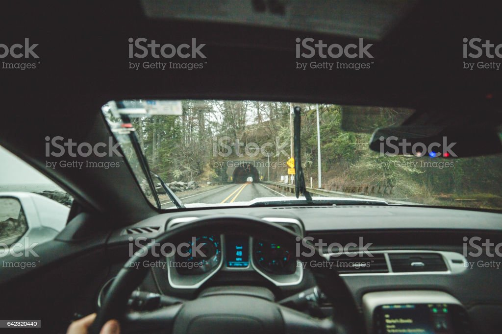 Driver point of view inside highway tunnel stock photo