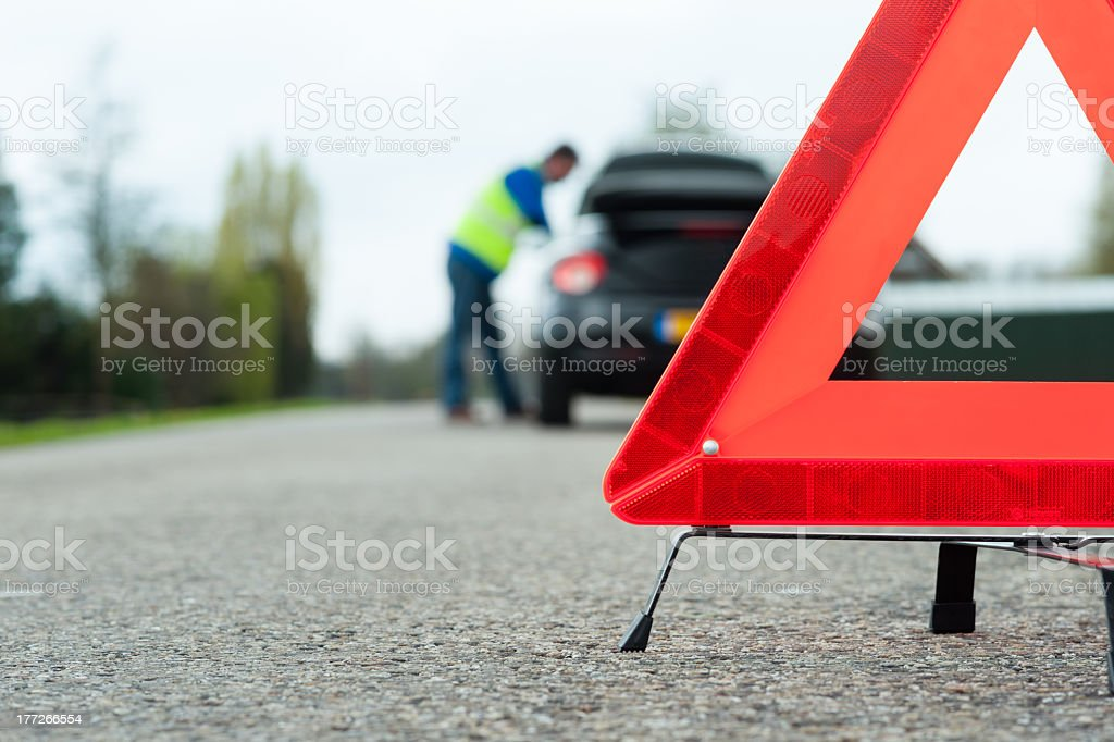 A driver receiving roadside assistance stock photo