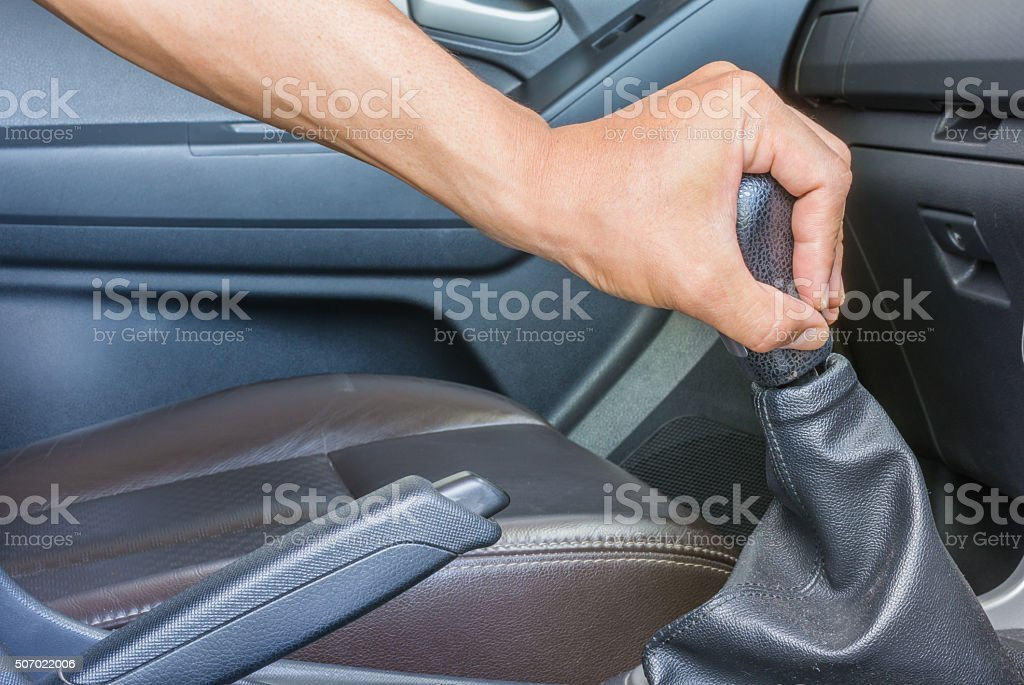 driver shifting the gear stick stock photo