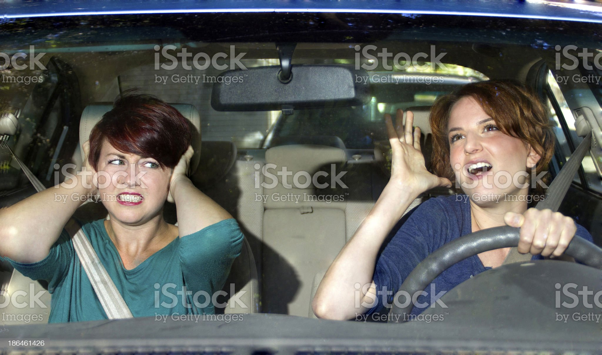 Driver Singing in the Car and Annoying a Passenger royalty-free stock photo