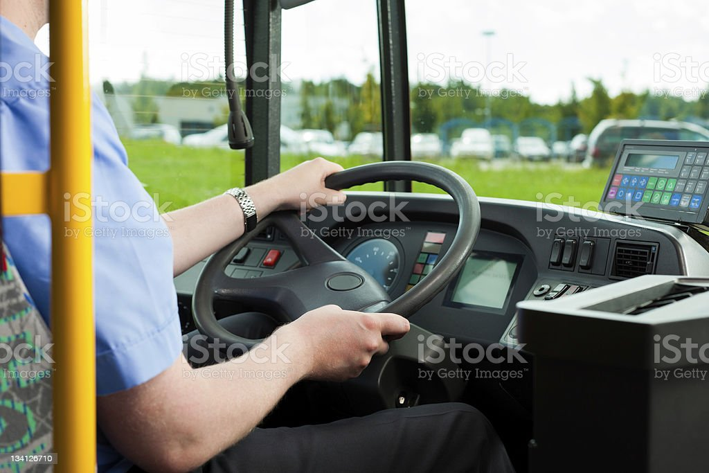 Driver sitting in his bus stock photo
