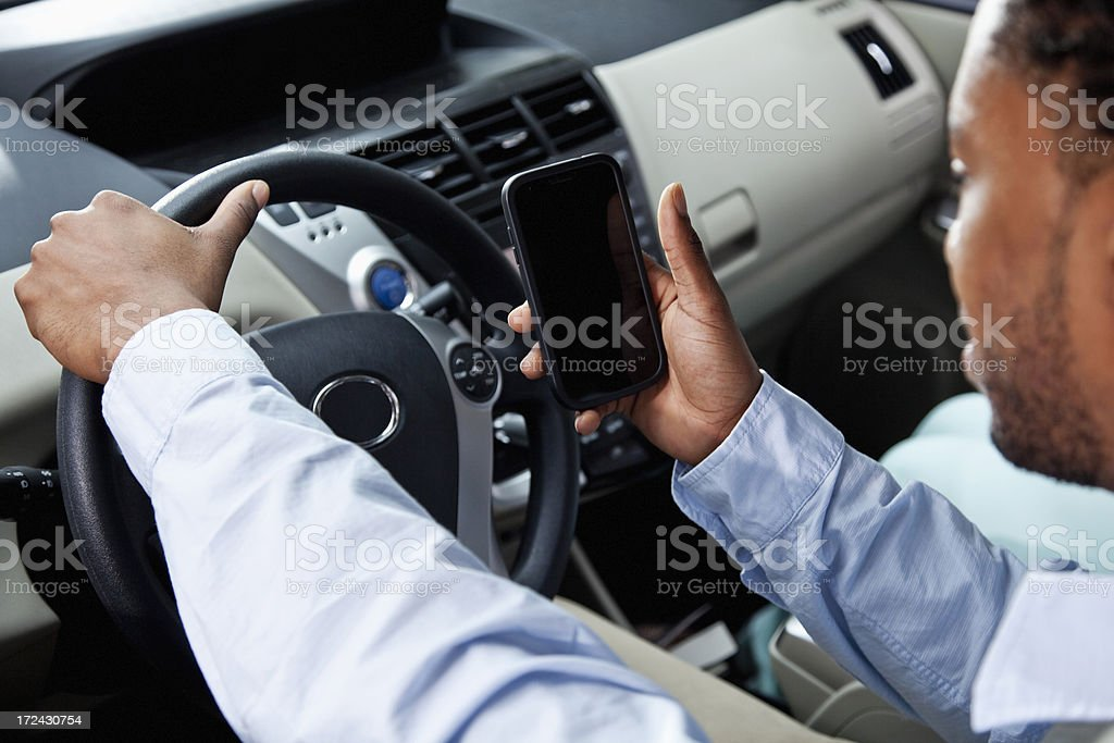 Driver using mobile phone stock photo